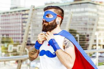 Hipster superhero adjusting his mantle