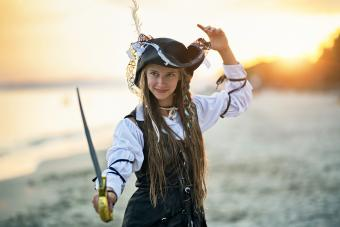 Cute pirate girl holding a sabre