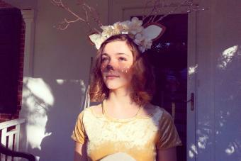 Teen girl dressed as a woodland deer