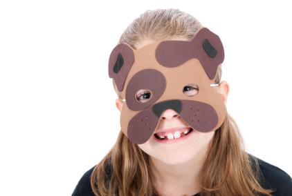 Child wearing dog mask