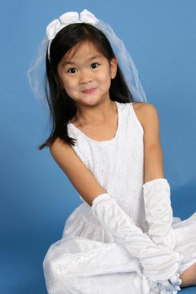 Child in a bride costume