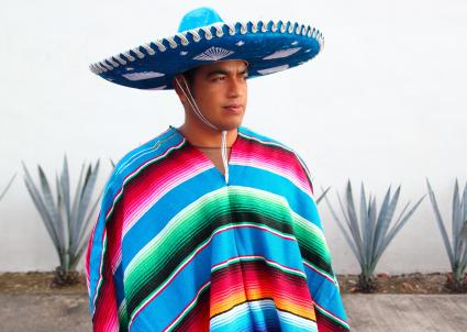 Mexican man wearing sombrero and poncho