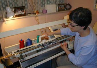 Woman at knitting machine