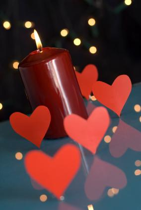 Valentine candle with paper hearts