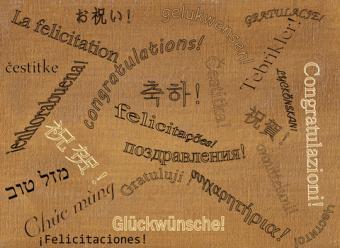 Hand stamped congratulations card; copyright Sandra Heath at Dreamstime.com