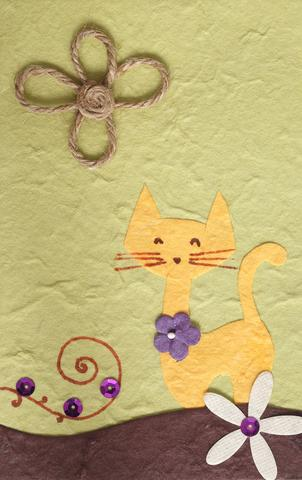 Handmade card with a cat on it; Copyright Piyato at Dreamstime.com