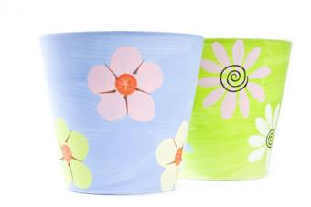 Hand painted flower pots; Copyright Chiyacat at Dreamstime.com