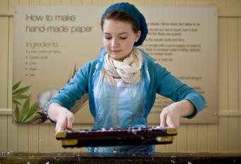 Making paper with a mold and deckle; copyright Bagwold at Dreamstime.com