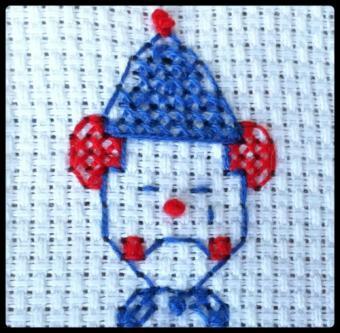sad clown finished cross stitch