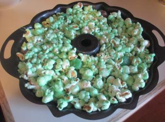 placing the popcorn in the cake pan