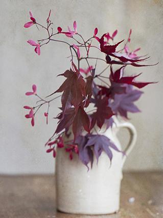 Fall foliage centerpiece in a white jug