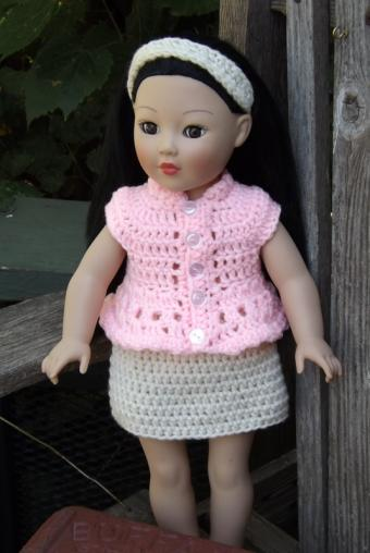 18-inch doll wearing pink crocheted shirt