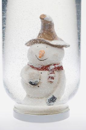 Snowman figure in snow globe
