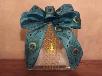 Lighted glass block with a bow