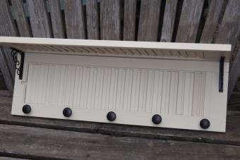 Evenly space and attach knobs.