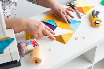 putting together pattern of colored fabric