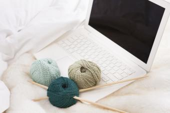 Knitting items and laptop