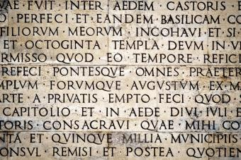 Latin inscription on the outside wall of Ara Pacis wall in Rome