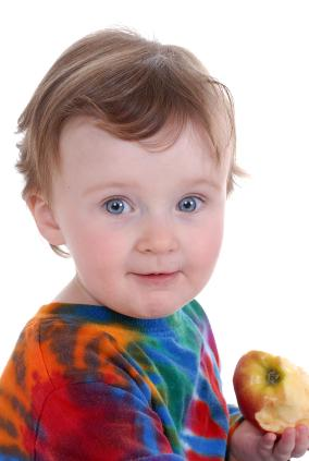 Baby wearing tie-dyed shirt