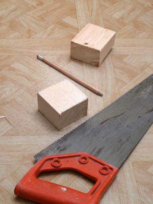wood blocks and hand saw