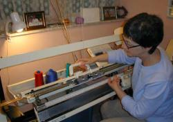 Woman at knitting machine