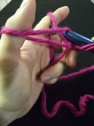 Step 3 of casting on a knitting stitch.