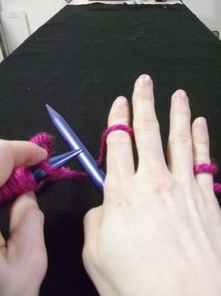 Step two of how to hold the yarn for knitting