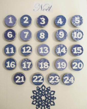 Noel themed calendar made with tiny tins