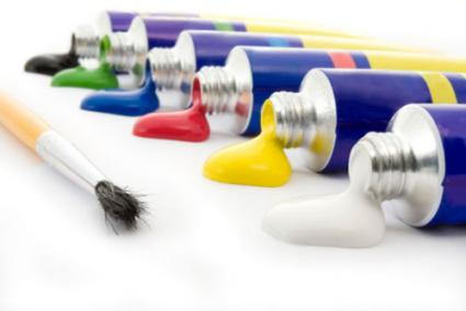 Brush and tubes of paint