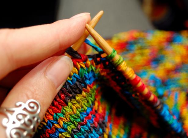 Woman holding knitting needles with yarn