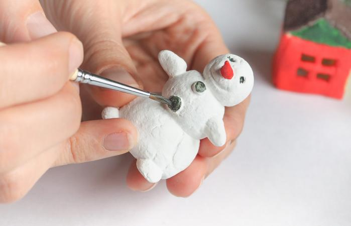 Handmade manufacture of a small toy snowman