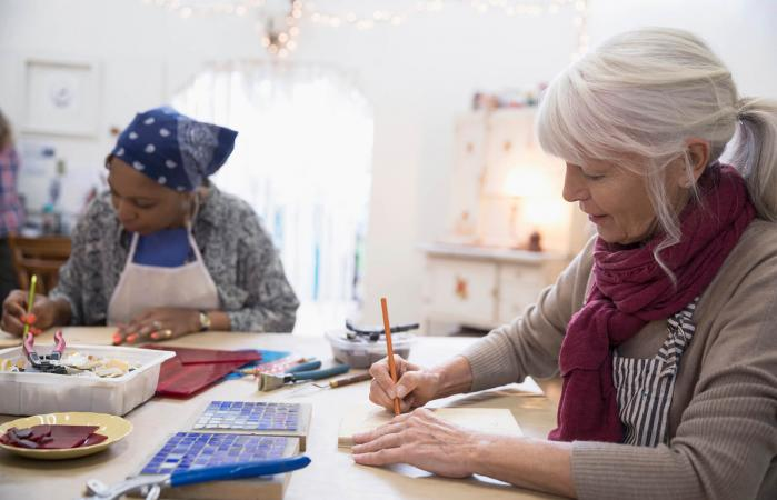 Senior woman enjoying craft class