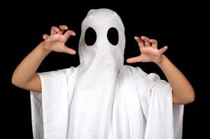 Boy dressed as ghost