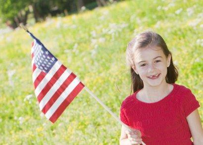 Little girl waving a flag on 4th of July