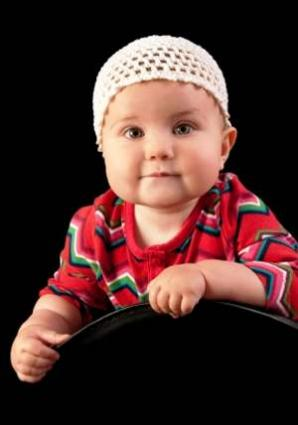 Infant wearing a simple crocheted beanie