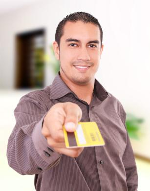 Man holding gold credit card