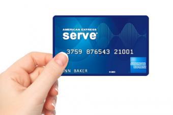 Female hand holding AMEX prepaid card