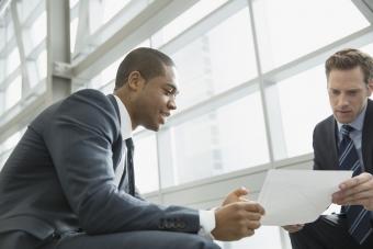 Businessmen discussing letter