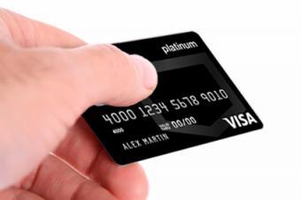 Hand holding platinum credit card