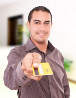 Man holding gold credit card