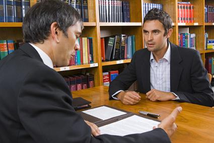 Man talking with an attorney