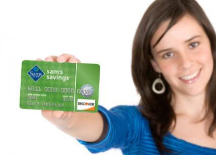 Woman holding Sam's Club Discover Card