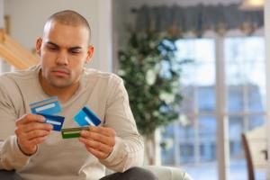 Man choosing credit cards