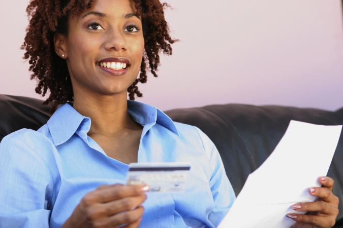 Woman holding credit card bill