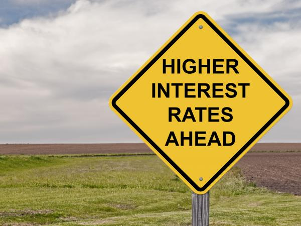 road sign warning of interest rates