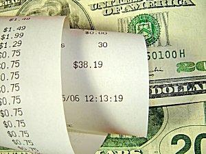 Rolled receipt and cash.
