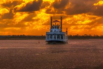 River tour boat at sunset