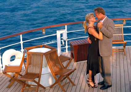 Couple dancing on cruise ship deck