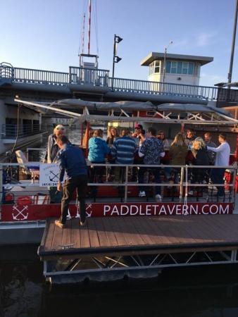 People boarding the Milwaukee Paddle Tavern