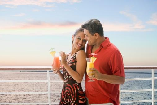 Couple with cocktails on cruise ship